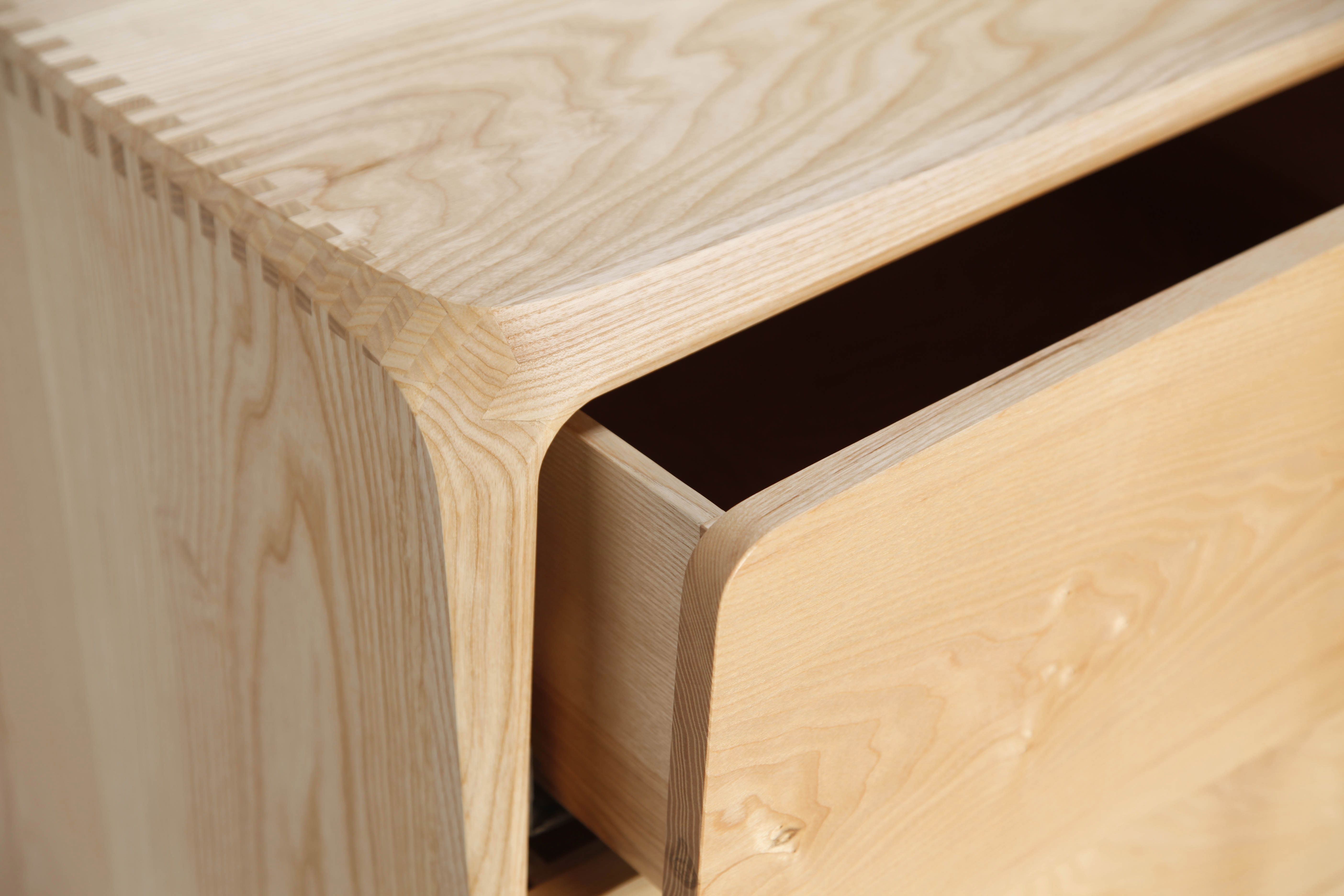 Hand shaped detail by our Cabinet Maker on this wooden chest of drawers
