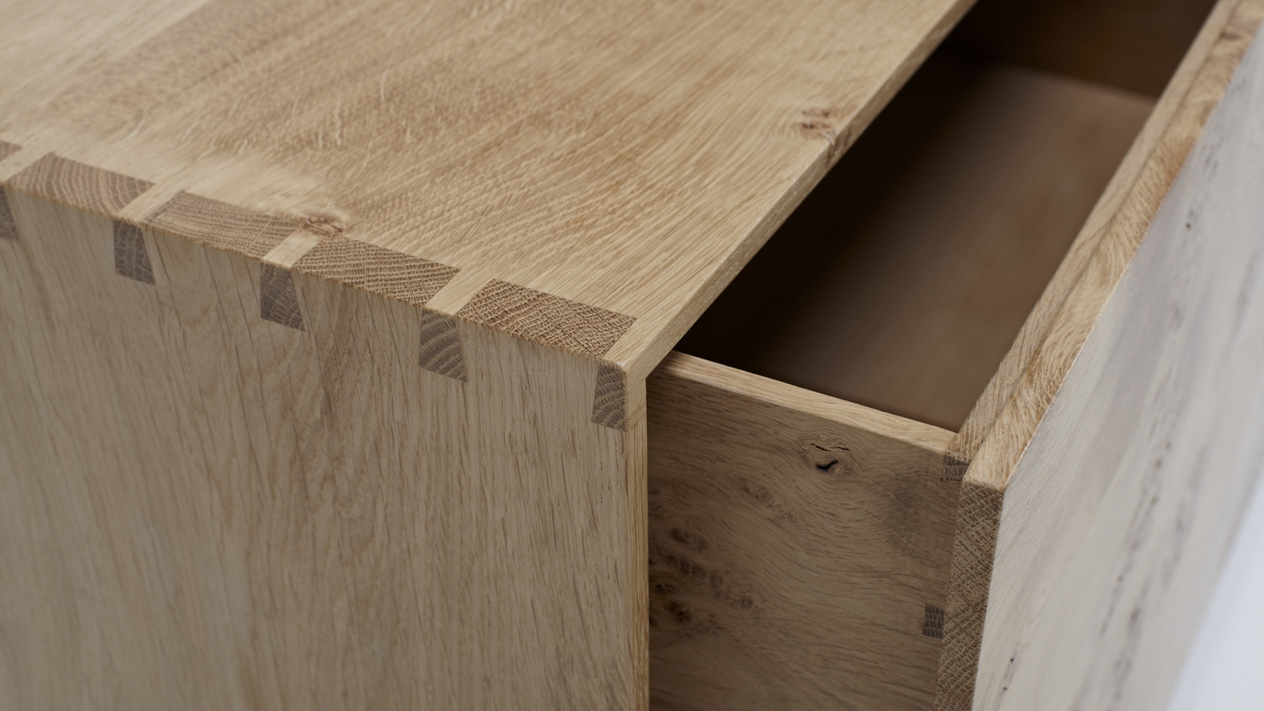 Dovetail detail on linen press: Furniture design by James Smith
