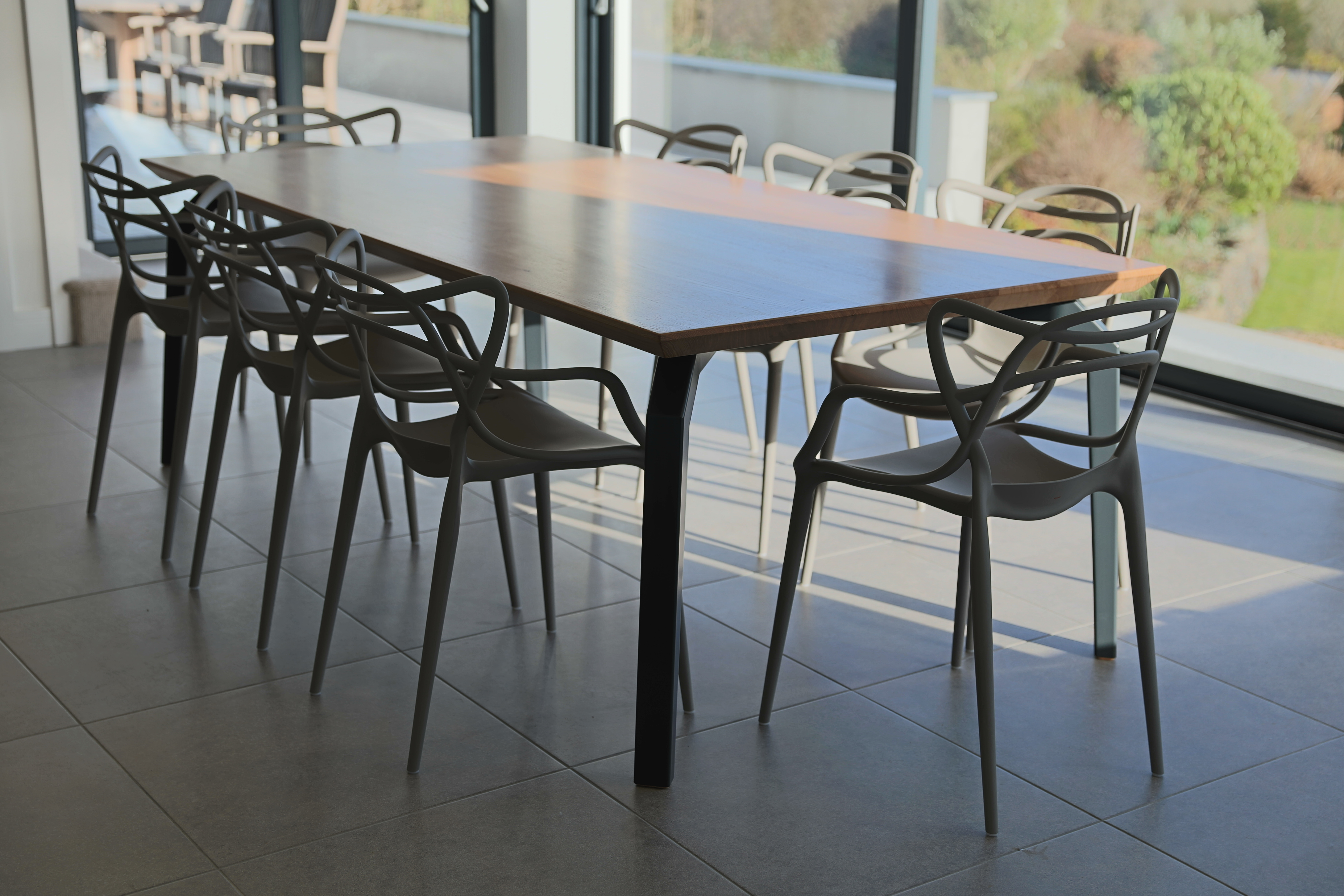 An interesting furniture design challenge, a dining table to complement a set of Philippe Starck 'Masters' chairs